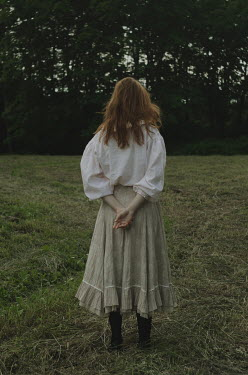 Daria Amaranth WOMAN WITH RED HAIR STANDING IN FIELD