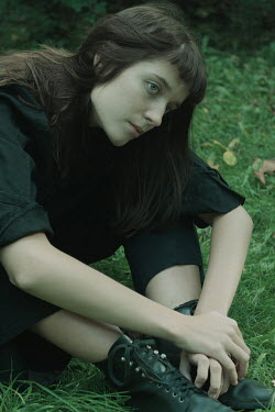 Daria Amaranth BRUNETTE GIRL WITH BOOTS SITTING ON GRASS