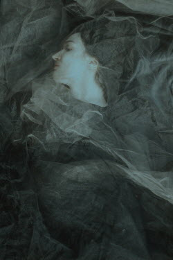 Daria Amaranth BRUNETTE WOMAN LYING COVERED WITH WHITE VEIL