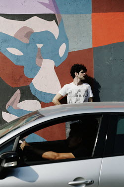 Giovan Battista D'Achille MEN DRIVING AND STANDING BY MURAL
