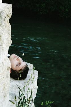 Giovan Battista D'Achille MAN LYING ON ROCK BY RIVER