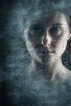 Magdalena Russocka young woman behind dirty wet window staring