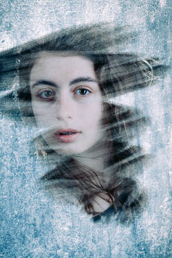 Magdalena Russocka young woman behind frozen window staring