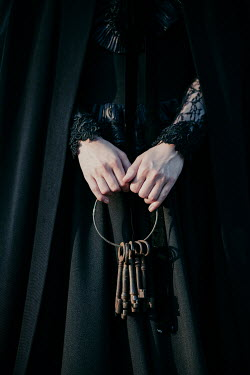 Magdalena Russocka close up of historical woman in black dress holding bunch of old keys