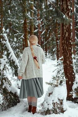 Nathalie Seiferth BLONDE GIRL STANDING IN SNOWY FOREST