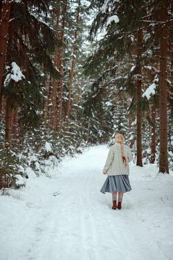 Nathalie Seiferth BLONDE GIRL WALKING ON SNOWY COUNTRY LANE