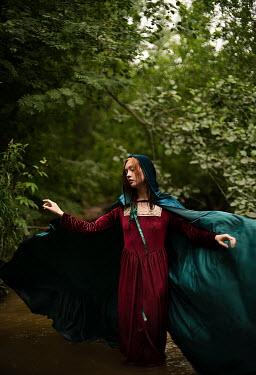Alexandra Bochkareva MEDIEVAL WOMAN WITH CAPE STANDING IN RIVER
