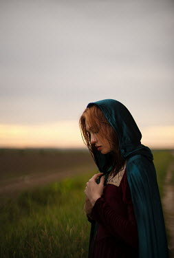 Alexandra Bochkareva MEDIEVAL WOMAN WITH CAPE IN COUNTRYSIDE