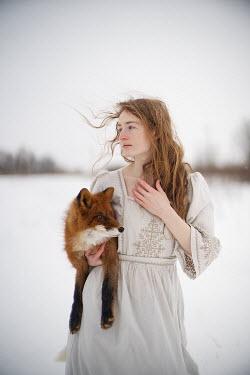 Alexandra Bochkareva GIRL IN SNOWY COUNTRYSIDE CARRYING FOX