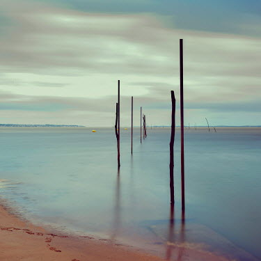 Christine Amat CALM SEA WITH WOODEN POSTS