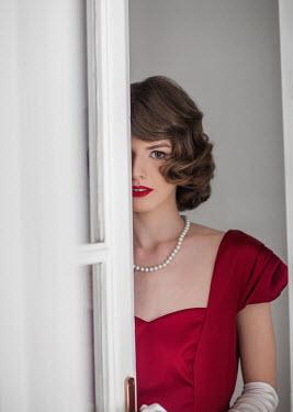 Nikaa RETRO WOMAN IN RED BY OPEN DOOR