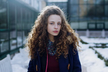 Irina Orwald GIRL OUTSIDE MODERN BUILDING IN SNOW