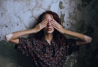 Irina Orwald WOMAN COVERING EYES WITH HANDS INDOORS