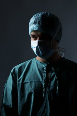 Magdalena Russocka male surgeon wearing scrub suit and mask