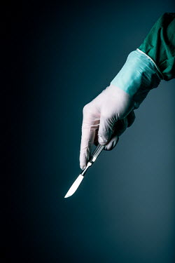Magdalena Russocka close up of hand of male surgeon holding scalpel