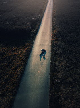 Magdalena Russocka body of modern man lying on country road from above