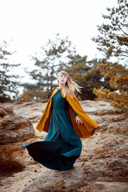Nathalie Seiferth GIRL IN DRESS AND CAPE ON ROCKY HILL