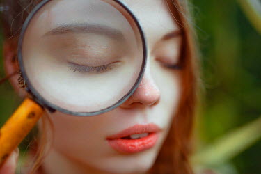 Nathalie Seiferth GIRL WITH MAGNIFYING GLASS OUTDOORS