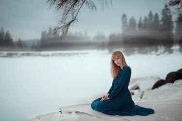 Nathalie Seiferth WOMAN SITTING BY FROZEN LAKE