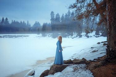 Nathalie Seiferth WOMAN STANDING BY FROZEN LAKE