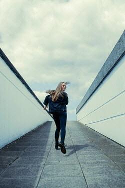 Shelley Richmond BLONDE GIRL RUNNING UP CONCRETE RAMP