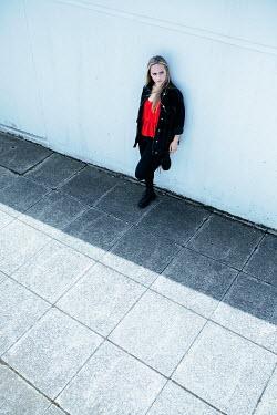 Shelley Richmond SERIOUS BLONDE GIRL WAITING IN PASSAGEWAY