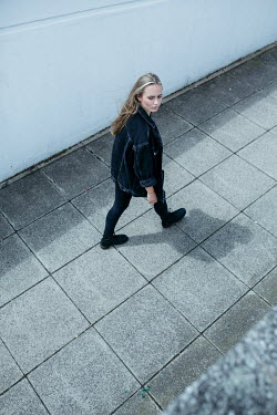 Shelley Richmond SERIOUS BLONDE GIRL WALKING IN PASSAGEWAY