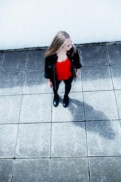 Shelley Richmond SERIOUS BLONDE GIRL STANDING IN PASSAGEWAY