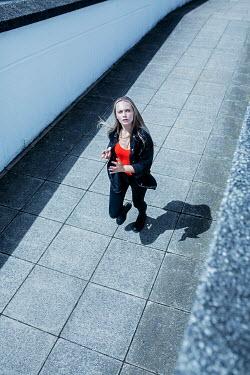 Shelley Richmond SERIOUS BLONDE GIRL RUNNING IN PASSAGEWAY