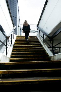 Shelley Richmond BLONDE GIRL CLIMBING STEPS IN CITY
