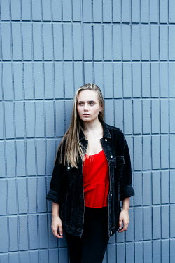 Shelley Richmond SERIOUS BLONDE GIRL WAITING BY CONCRETE WALL