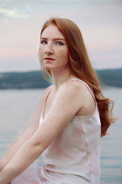 Jasenka Arbanas GIRL WITH RED HAIR AND FRECKLES SITTING BY LAKE