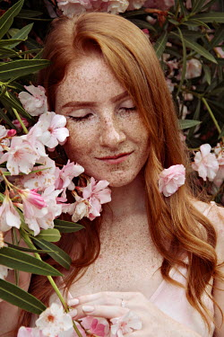 Jasenka Arbanas GIRL WITH RED HAIR DAYDREAMING BY PINK FLOWERS