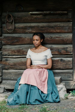 Magdalena Russocka historical african woman sitting by old cabin