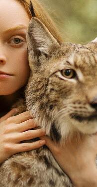 Alexandra Bochkareva SERIOUS GIRL WITH LARGE CAT OUTDOORS