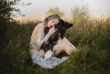 Alexandra Bochkareva WOMAN IN GLITTERY DRESS SITTING WITH FOX OUTDOORS