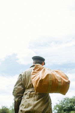 Shelley Richmond MAN IN FLYING SUIT WITH BAG OVER SHOULDER