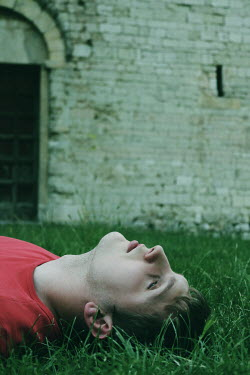 Giovan Battista D'Achille MAN LYING ON GRASS OUTSIDE CASTLE