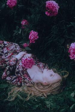 Irina Orwald BLONDE WOMAN  LYING IN GARDEN WITH FLOWERS