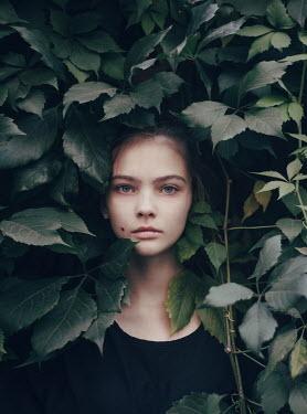Irina Orwald SERIOUS YOUNG GIRL STANDING IN BUSH