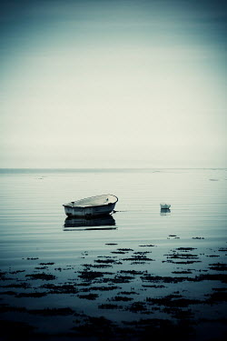 Carmen Spitznagel SMALL ROWING BOAT MOORED ON CALM SEA