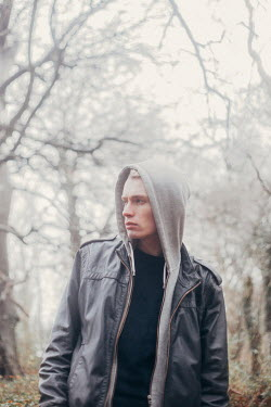 Eve North SERIOUS MAN WITH HOOD IN FOREST