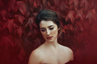Eve North BRUNETTE WOMAN OUTDOORS BY BY RED CREEPER