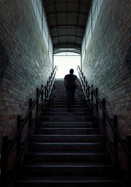 Jaroslaw Blaminsky MAN IN SHADOW CLIMBING STEPS