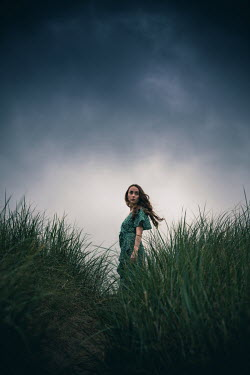 Marie Carr WOMAN WITH GREEN DRESS IN LONG GRASS