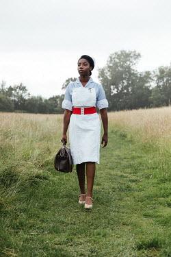 Matilda Delves NURSE WALKING IN COUNTRYSIDE CARRYING BAG
