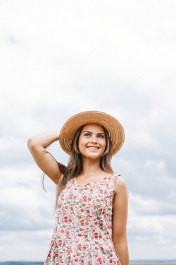Shelley Richmond HAPPY GIRL IN FLORAL DRESS AND HAT OUTDOORS