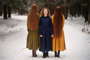 Alexandra Bochkareva THREE WOMEN STANDING IN SNOWY COUNTRYSIDE