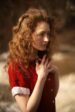 Alexandra Bochkareva WOMAN WITH RED HAIR AND DRESS OUTDOORS