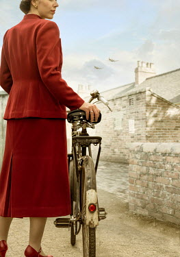 CollaborationJS RETRO WOMAN WITH BICYCLE IN WARTIME VILLAGE